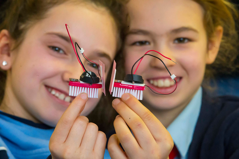 "06/03/2017. FREE TO USE IMAGE. Engineers Week at WIT (Waterford Institute of Technology). Pictured during ""BrushBots Workshop"" are Aoife Laigan and Eábha Doyle pupils from Scoil Mholainge, Listerlin, Co. Kilkenny. Picture: Patrick Browne"