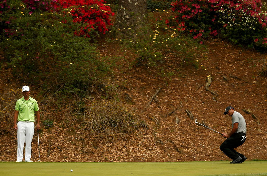 . Tiger Woods of the U.S. (R) reacts to missing a birdie putt on the 12th green as John Piercy of the U.S. watches during first round play in the 2013 Masters golf tournament at the Augusta National Golf Club in Augusta, Georgia, April 11, 2013.   REUTERS/Mark Blinch