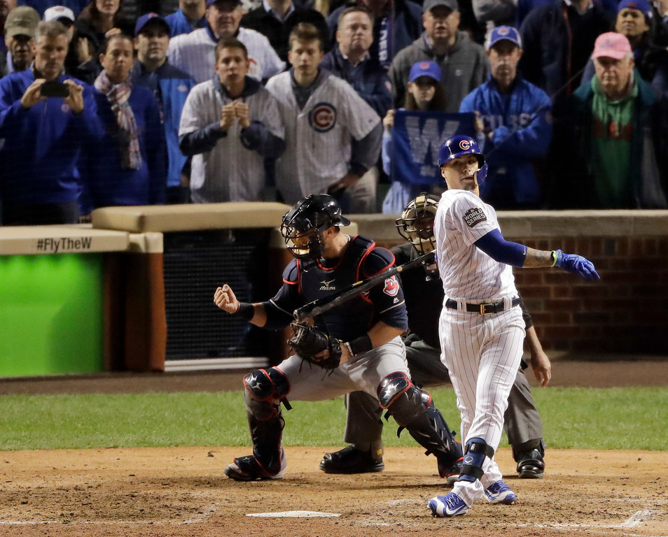 . Cleveland Indians catcher Yan Gomes, left, celebrates after Chicago Cubs\' Javier Baez makes the final out in Game 3 of the Major League Baseball World Series Friday, Oct. 28, 2016, in Chicago. The Indians won 1-0 to take a 2-1 lead in the series. (AP Photo/Charlie Riedel)