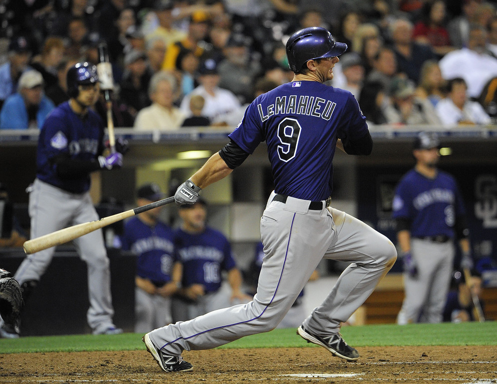 . DJ LeMahieu #9 of the Colorado Rockies hits a single during the third inning of a baseball game against the San Diego Padres at Petco Park on July 10, 2013 in San Diego, California.  (Photo by Denis Poroy/Getty Images)