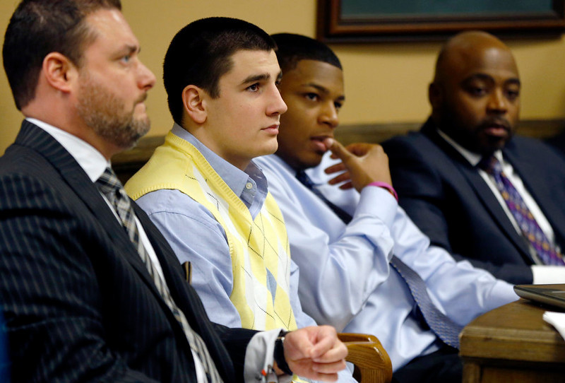 . From left, Defense attorney Adam Nemann, his client, defendant Trent Mays, 17, defendant 16-year-old Ma\'lik Richmond and his attorney, Walter Madison, listen to testimony during Mays and Richmond\'s trial on rape charges in juvenile court on Thursday, March 14, 2013 in Steubenville, Ohio. Mays and Richmond are accused of raping a 16-year-old West Virginia girl in August of 2012. (AP Photo/Keith Srakocic, Pool)