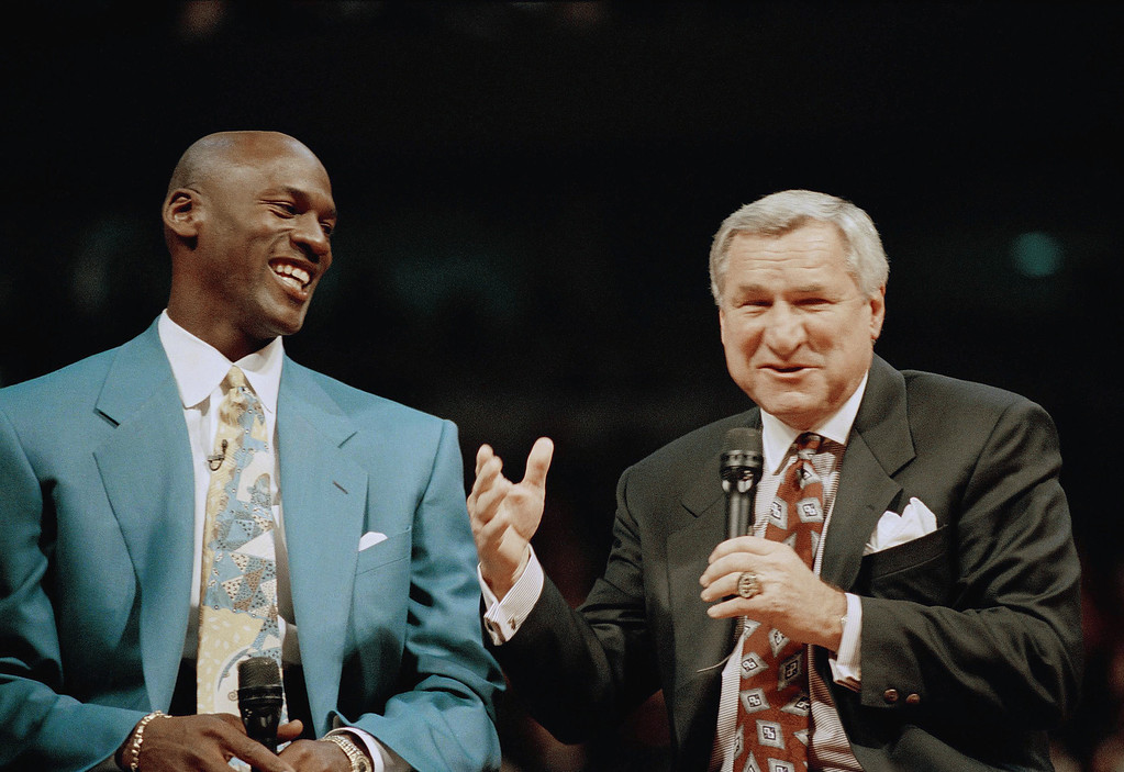 ". FILE - In a Nov. 1, 1994 file photo, former Chicago Bulls great Michael Jordan shares a moment with Dean Smith, his former coach at North Carolina, during ceremonies honoring Jordan at Chicago\'s United Center.  Smith, the North Carolina basketball coaching great who won two national championships, died ""peacefully\"" at his home Saturday night, Feb. 7, 2015, the school said in a statement Sunday from Smith\'s family. He was 83. (AP Photo/Pool, File)"