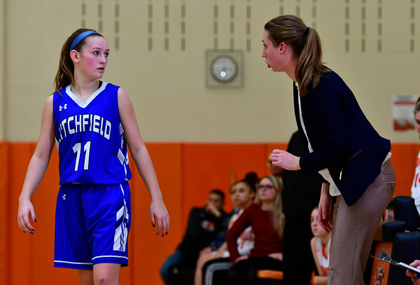 12/21/2018 Mike Orazzi | Staff Litchfield's Mackenzie Schweter (11) and head coach Paige Young during Friday night's girls basketball game with Terryville in Plymouth.