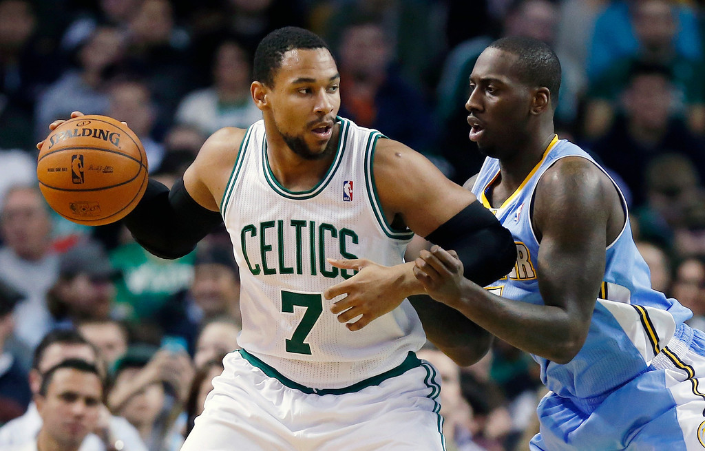 . Denver Nuggets\' J.J. Hickson, right, defends against Boston Celtics\' Jared Sullinger (7) in the second quarter of an NBA basketball game in Boston, Friday, Dec. 6, 2013. (AP Photo/Michael Dwyer)