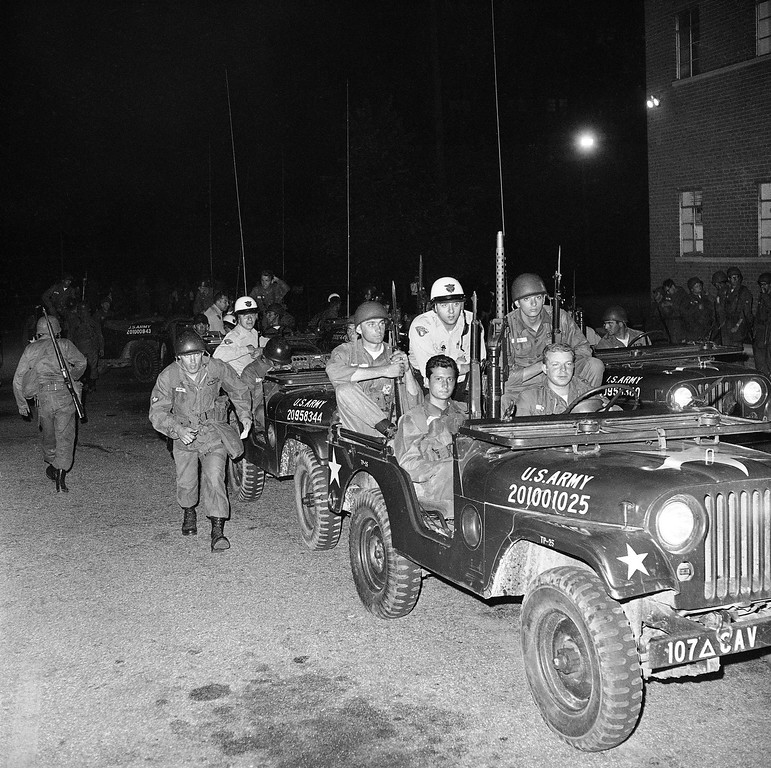 . National Guardsmen and Cleveland policemen (white helmets) teamed up in jeep patrol of the riot-wracked Hough area on Cleveland?s east side, July 21, 1966. Dispatched from assembly points like the one shown here, the jeeps rolled to trouble spots quickly. (AP Photo)