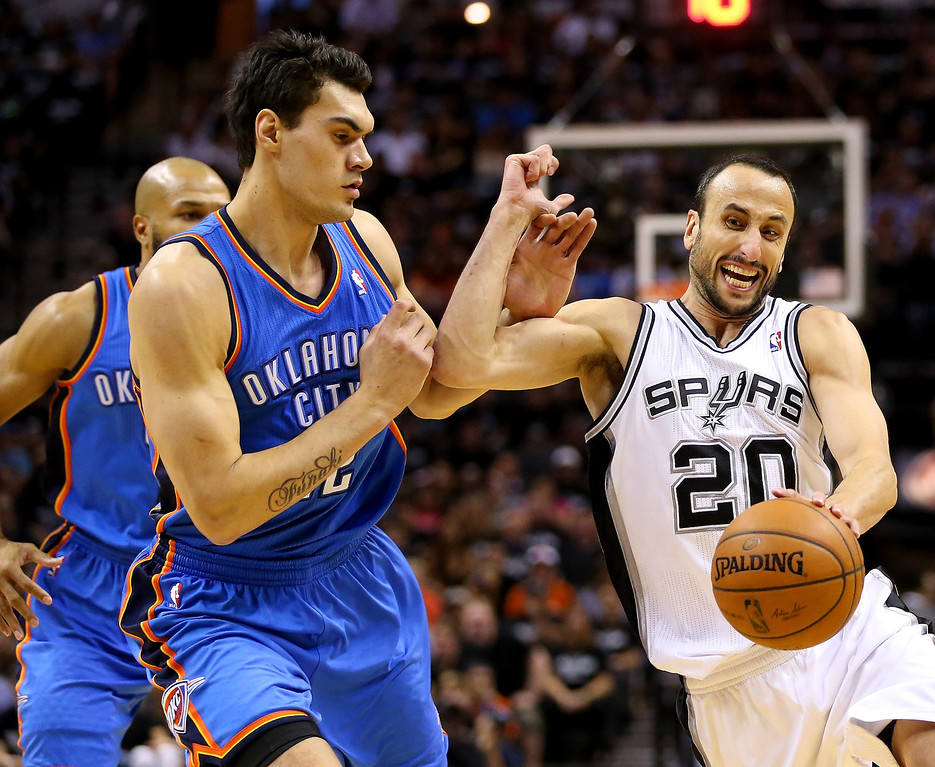 . Manu Ginobili #20 of the San Antonio Spurs drives on Steven Adams #12 of the Oklahoma City Thunder in the first quarter in Game One of the Western Conference Finals during the 2014 NBA Playoffs at AT&T Center on May 19, 2014 in San Antonio, Texas.  (Photo by Ronald Martinez/Getty Images)