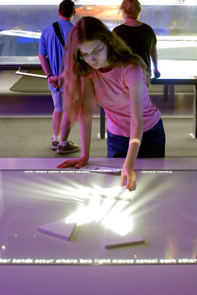 Playing on a light refraction table at MOSI.jpg