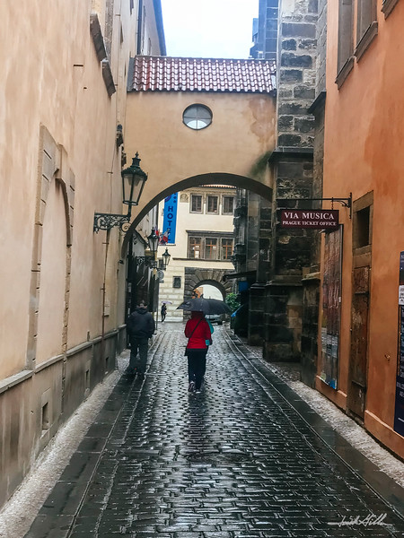 Walking in the rainin Old Town Square