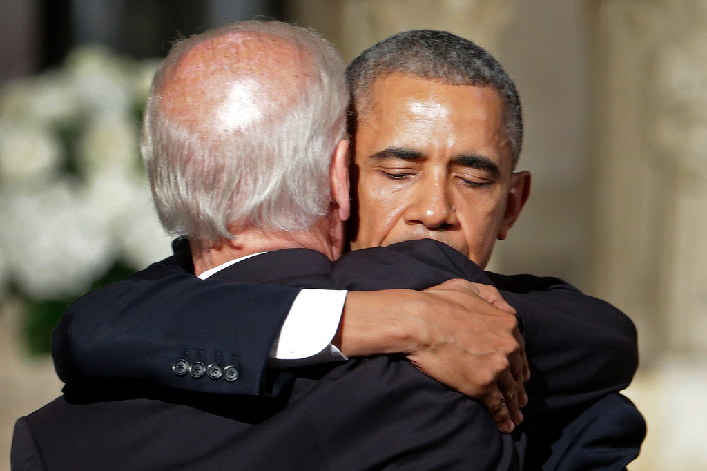 . President Barack Obama hugs Vice President Joe Biden after delivering the eulogy in honor of Biden\'s son, former Delaware Attorney General Beau Biden, Saturday, June 6, 2015, at St. Anthony of Padua Church in Wilmington, Del. Biden, Vice President Biden\'s eldest son, died at the age of 46 after a battle with brain cancer. (AP Photo/Pablo Martinez Monsivais, Pool)