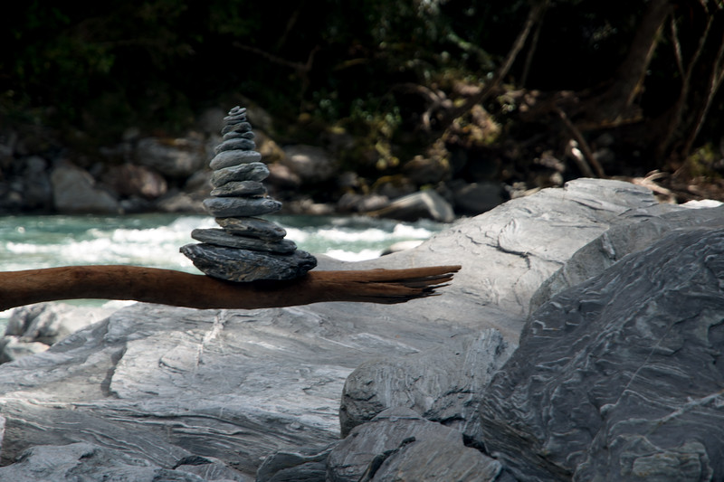 stacked stones on balanced log-1.jpg