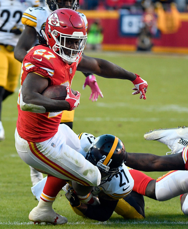 . Kansas City Chiefs running back Kareem Hunt (27) is tackled by Pittsburgh Steelers cornerback Joe Haden (21) during the second half of an NFL football game in Kansas City, Mo., Sunday, Oct. 15, 2017. (AP Photo/Ed Zurga)