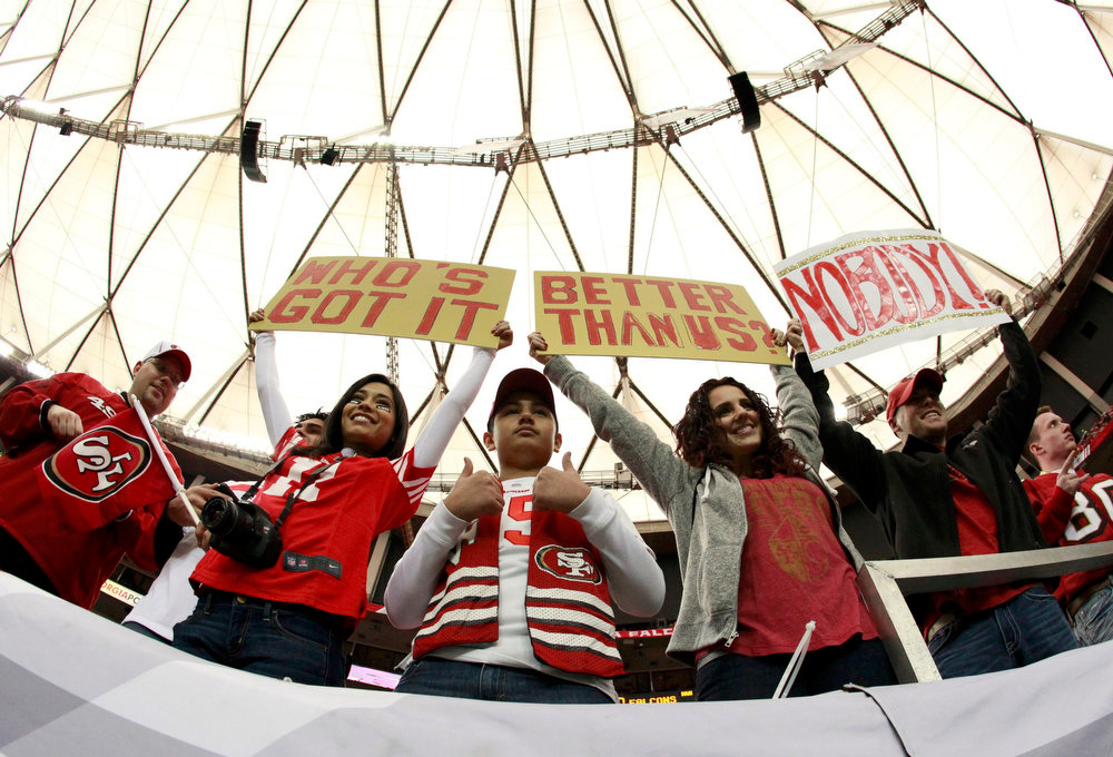 Description of . San Francisco 49ers fans display signs as they await the start of the NFL NFC Championship football game against the Atlanta Falcons in Atlanta, Georgia January 20, 2013.  REUTERS/Sean Gardner