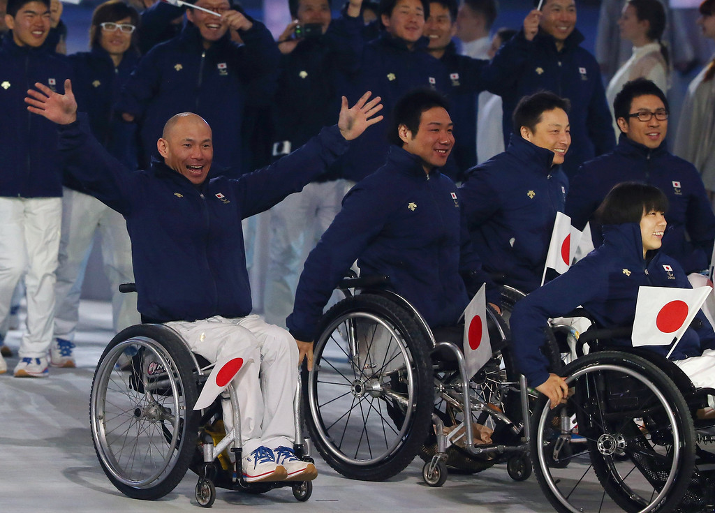 . Japan enters the arena during the Opening Ceremony of the Sochi 2014 Paralympic Winter Games at Fisht Olympic Stadium on March 7, 2014 in Sochi, Russia.  (Photo by Ronald Martinez/Getty Images)