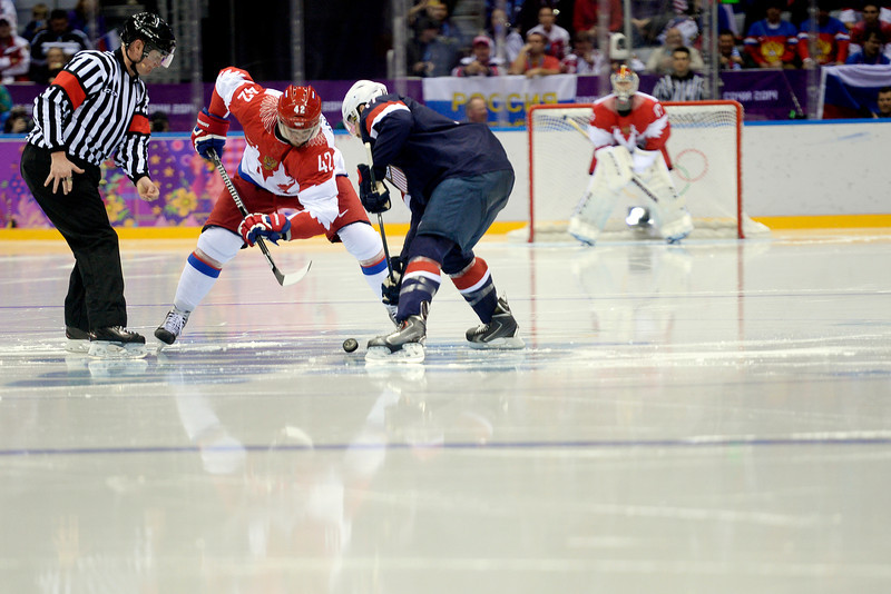 . Artyom Anisimov (42) of the Russia and Ryan Kesler (17) of the U.S.A. face off during the second period of men\'s hockey action at Bolshoy arena. Sochi 2014 Winter Olympics on Saturday, February 15, 2014. (Photo by AAron Ontiveroz/The Denver Post)