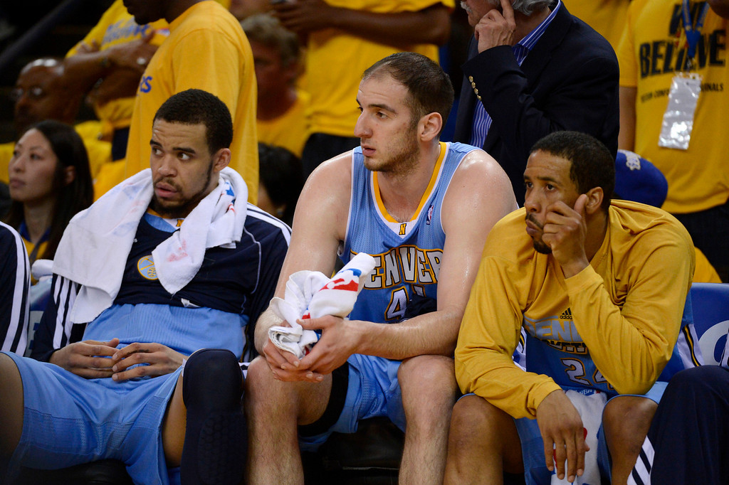 . JaVale McGee (34) of the Denver Nuggets, Kosta Koufos (41) and Andre Miller (24) of the Denver Nuggets sit dejected on the bench late in the fourth quarter after their loss to the Golden State Warriors 115-101 in Game 4 of the first round NBA Playoffs April 28, 2013 at Oracle Arena. (Photo By John Leyba/The Denver Post)