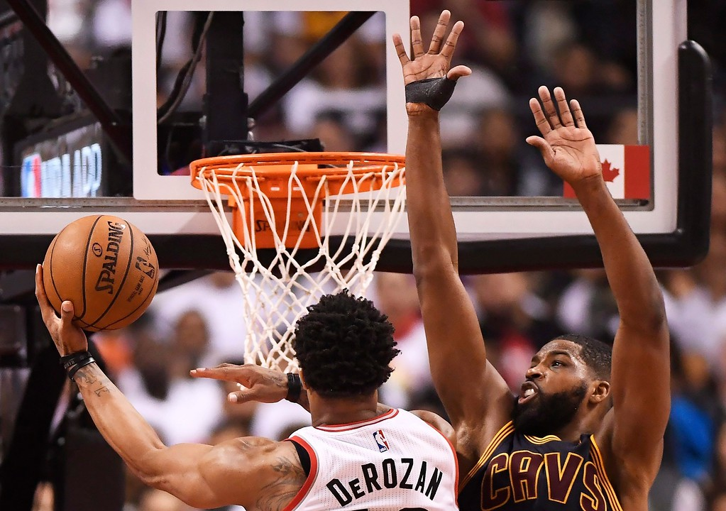 . Toronto Raptors guard DeMar DeRozan, left, drives past Cleveland Cavaliers center Tristan Thompson (13) during the second half of Game 3 of an NBA basketball second-round playoff series in Toronto on Friday, May 5, 2017. (Frank Gunn/The Canadian Press via AP)