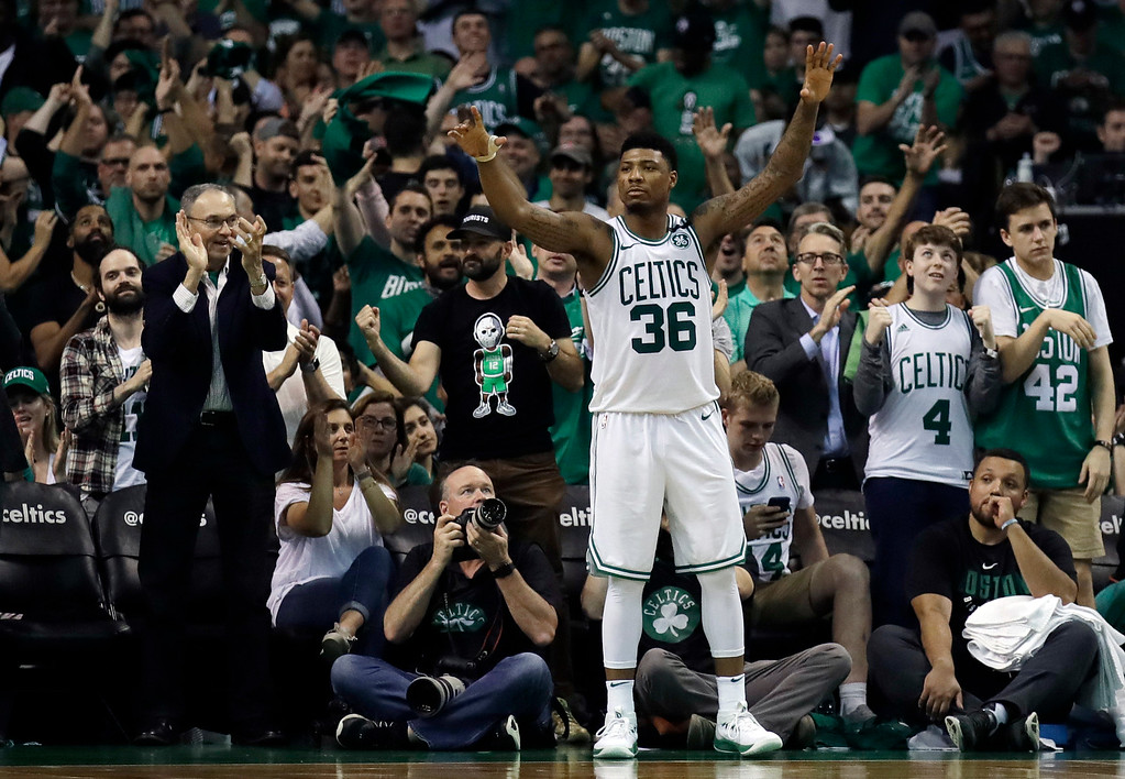 . Boston Celtics guard Marcus Smart (36) celebrates near the end Game 5 against the Boston Celtics in the NBA basketball Eastern Conference finals Wednesday, May 23, 2018, in Boston. The Celtics won 96-83. (AP Photo/Charles Krupa)