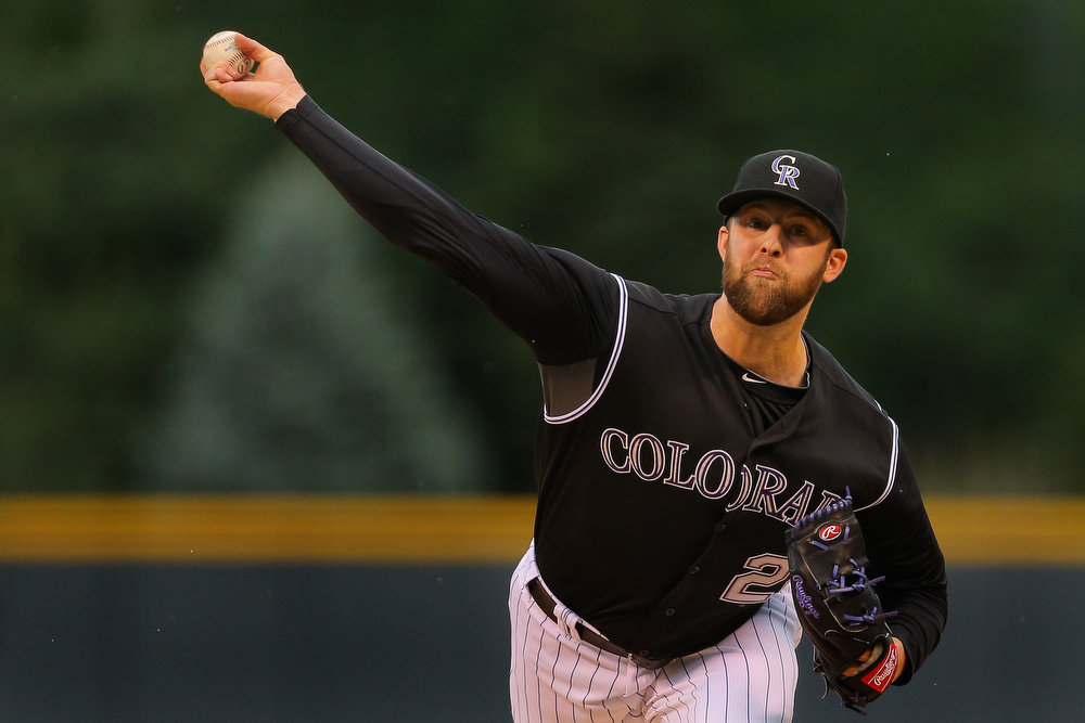 . Starting pitcher Jordan Lyles #24 of the Colorado Rockies delivers to home plate during the first inning against the Cincinnati Reds at Coors Field on August 17, 2014 in Denver, Colorado. (Photo by Justin Edmonds/Getty Images)