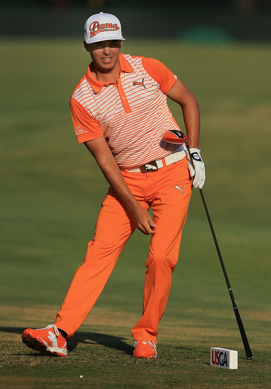 . Rickie Fowler of the United States watches his tee shot on the 13th hole during the final round of the 114th U.S. Open at Pinehurst Resort & Country Club, Course No. 2 on June 15, 2014 in Pinehurst, North Carolina.  (Photo by David Cannon/Getty Images)