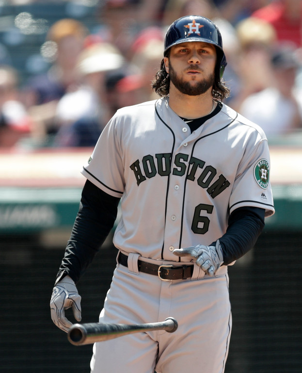 . Houston Astros\' Jake Marisnick throws his bat after striking out against Cleveland Indians starting pitcher Trevor Bauer in the seventh inning of a baseball game, Sunday, May 27, 2018, in Cleveland. (AP Photo/Tony Dejak)