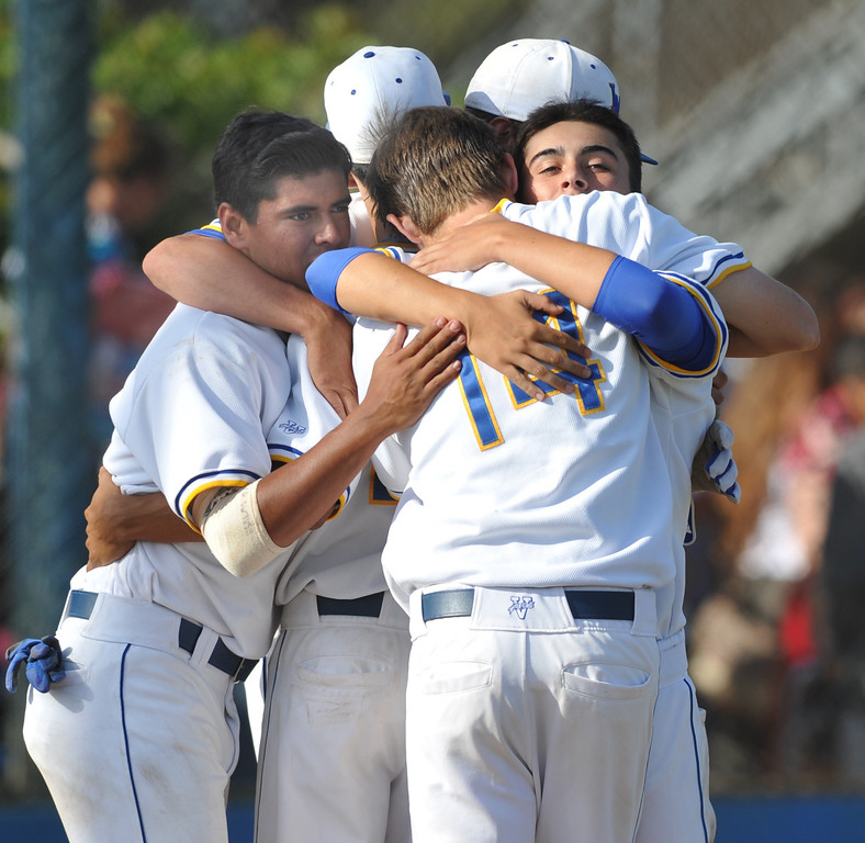 . La Mirada teammates hug at home plate after their loss to Los Osos in their CIF quarterfinal baseball game at La Mirada High School on Friday May 24, 2013. Los Osos beat La Mirada 8-5. (SGVN/Staff Photo by Keith Durflinger)