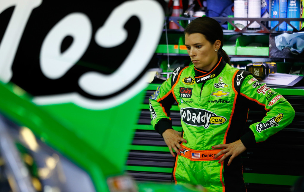 . LOUDON, NH - JULY 13:  Danica Patrick, driver of the #10 GoDaddy.com Chevrolet, looks over her car during practice for the NASCAR Sprint Cup Series Camping World RV Sales 301 at New Hampshire Motor Speedway on July 13, 2013 in Loudon, New Hampshire.  (Photo by Jared Wickerham/Getty Images)