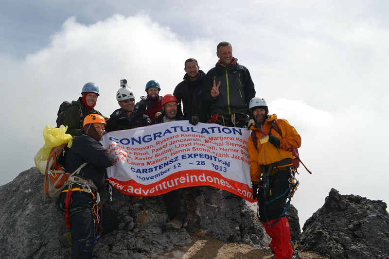 On November 20th , all 8 of us summited Carstensz Pyramid. Our host company: Adventure Indonesia has prepared a nice banner for us…