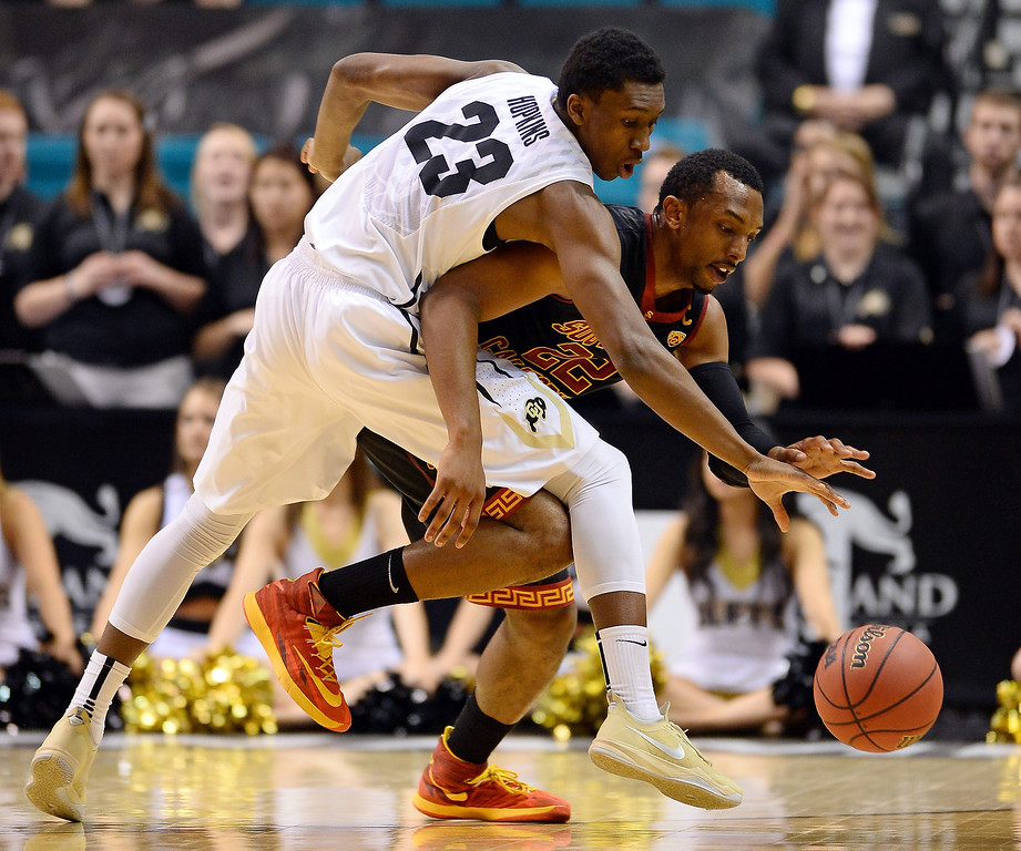 . Jaron Hopkins #23 of the Colorado Buffaloes and Byron Wesley #22 of the USC Trojans go after a loose ball during a first-round game of the Pac-12 Basketball Tournament at the MGM Grand Garden Arena on March 12, 2014 in Las Vegas, Nevada.  (Photo by Ethan Miller/Getty Images)