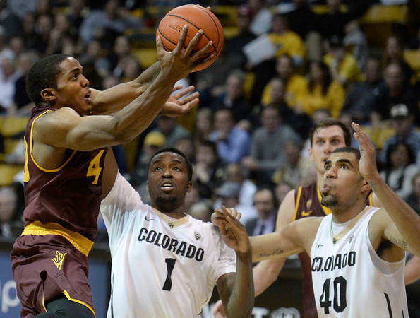 . Colorado\'s Wesley Gordon, center, and Josh Scott watch as Bo Barnes drives past them to the hoop during a game against Arizona State on Wednesday, Feb. 19, in Broomfield, Colorado. Jeremy Papasso/Boulder Daily Camera