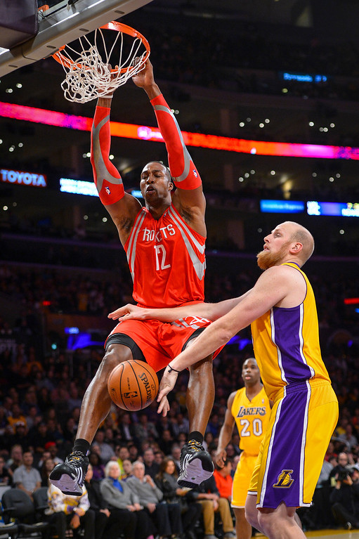 . Rockets� Dwight Howard slams in two as Lakers� Chris Kaman defends on the play during first half action at Staples Center Wednesday, February 19, 2014. ( Photo by David Crane/Los Angeles Daily News )