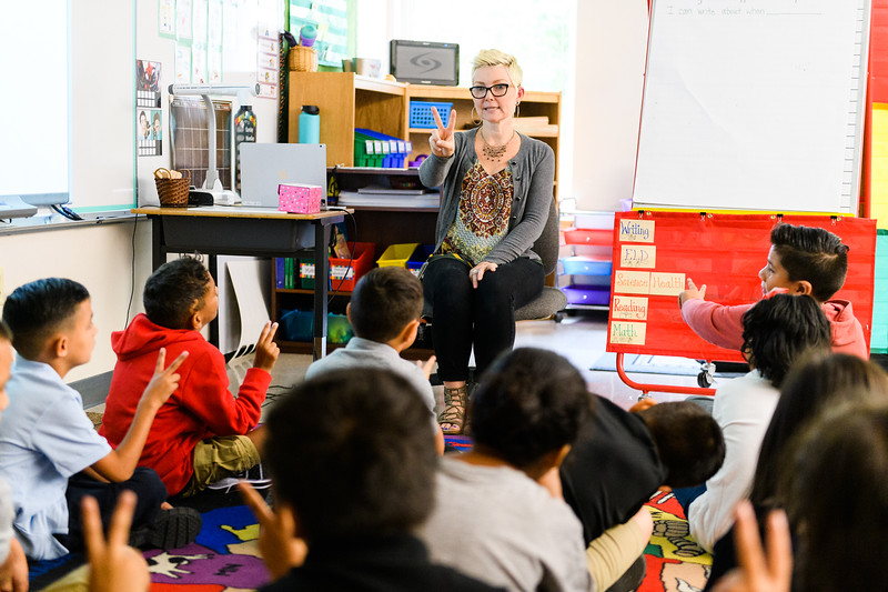 Second-grade teacher Carrie Clancy practices sign language with her class. Back to school day at Hallman Elementary School on Wednesday, September 4, 2019 in Salem, Ore.