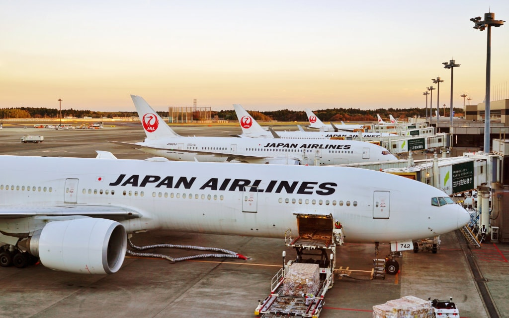 Japan Airlines planes at Narita International Airport. Editorial credit: EQRoy / Shutterstock.com