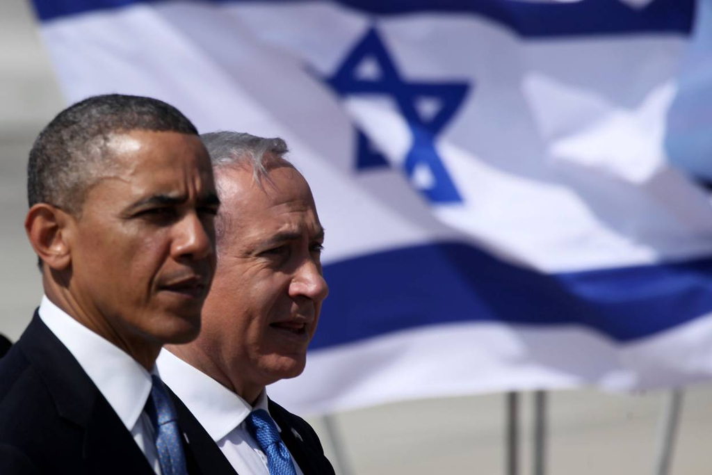 . U.S. President Barack Obama (L) is greeted by Israeli Prime Minister Benjamin Netanyahu during an official welcoming ceremony on his arrival at Ben Gurion International Airport on March, 20, 2013 near Tel Aviv, Israel. (Photo by Marc Israel Sellem-Pool/Getty Images)