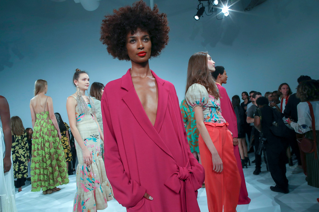 . Models present the Tracy Reese Spring 2018 collection during New York Fashion Week, Sunday, Sept. 10, 2017. (AP Photo/Mary Altaffer)
