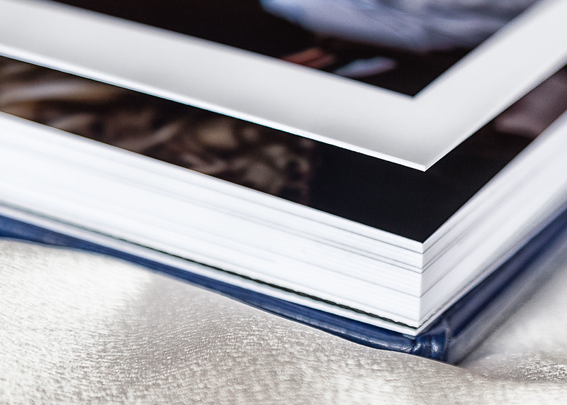 Thick pages confers heaviness to the album by adding an insert between the pages.