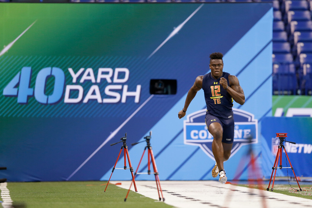 . Miami tight end David Njoku runs the 40-yard dash at the NFL football scouting combine in Indianapolis, Saturday, March 4, 2017. (AP Photo/Michael Conroy)