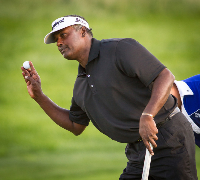 Vijay Singh waves to crowd after making birdie on 17.  Singh was tied for the lead at the BMW Championship in Carmel Indiana on Saturday Sept. 8, 2012. (Charles Cherney/WGA)