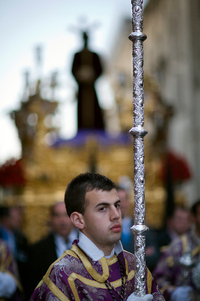 Acolyte in front of a float with the image of Christ, Holy Week 2008, Seville, Spain