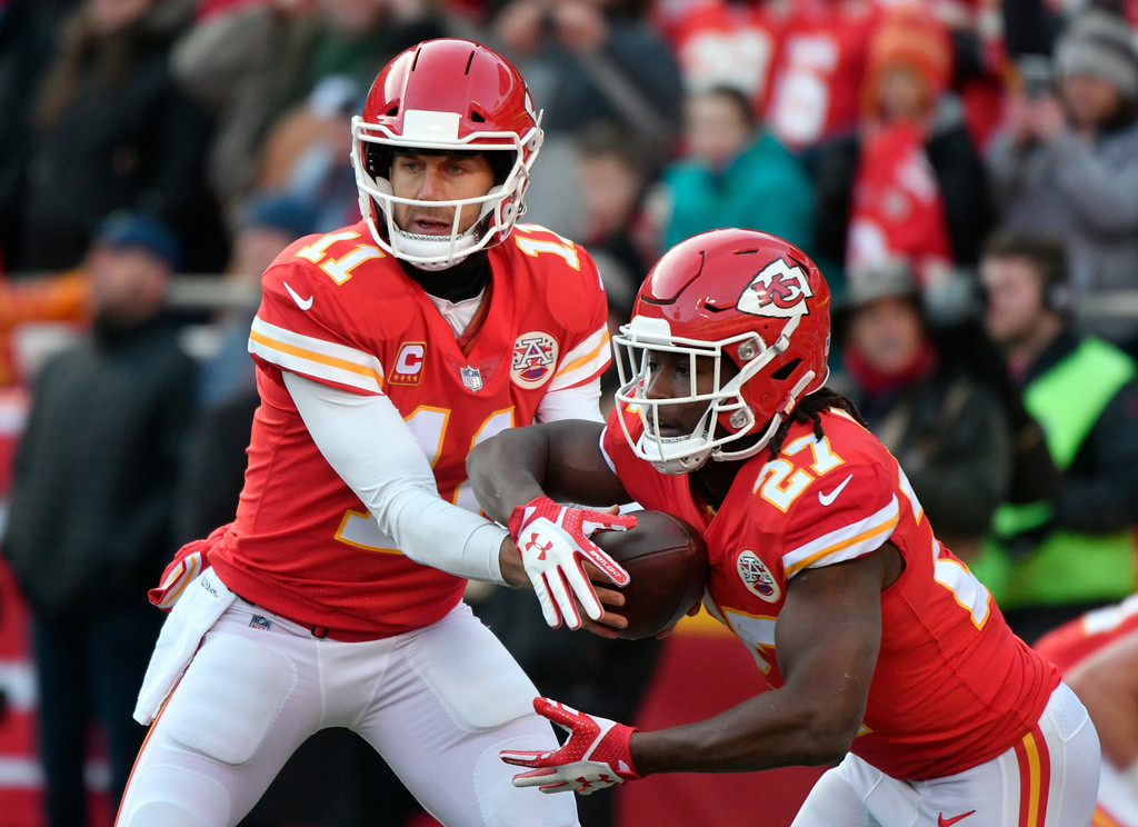 . Kansas City Chiefs quarterback Alex Smith (11) hands the ball off to running back Kareem Hunt (27) during warmups before an NFL wild-card playoff football game against the Tennessee Titans, in Kansas City, Mo., Saturday, Jan. 6, 2018. (AP Photo/Ed Zurga)
