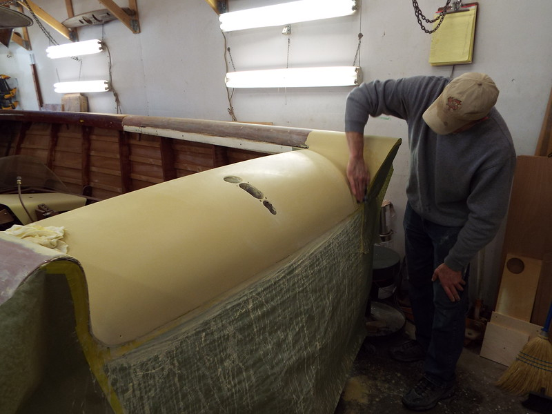 Wet sanding the third and final coat of primer.