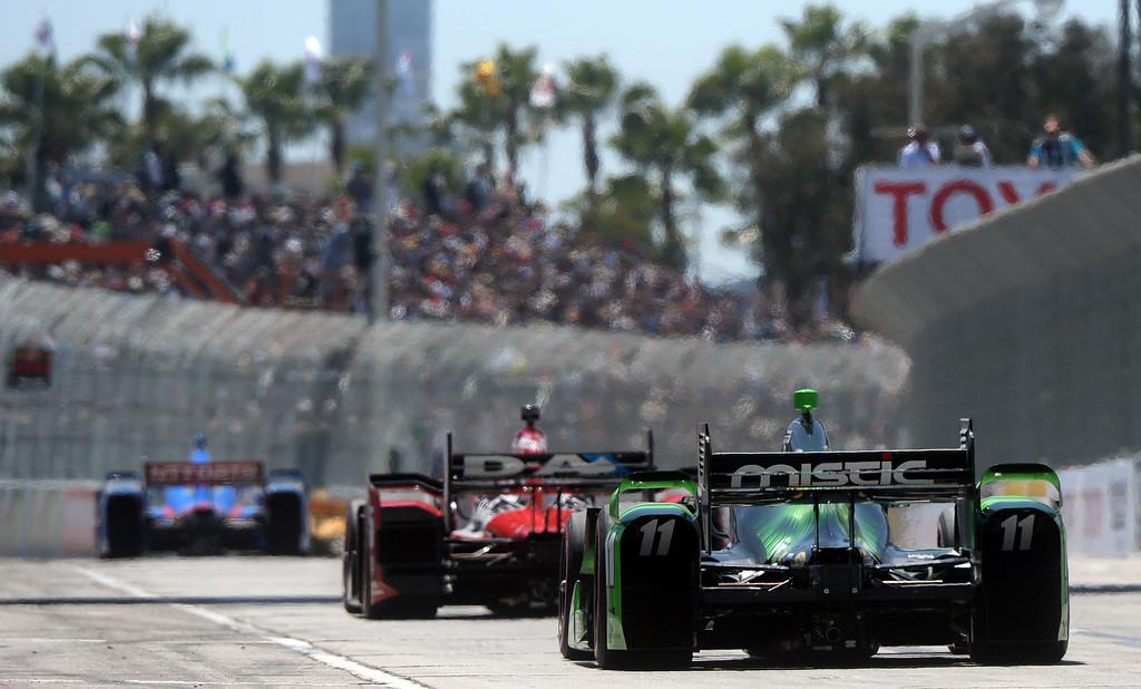 . Cars race down Shoreline Drive Sunday. Scott Dixon (9) wins the Toyota Grand Prix of Long Beach Sunday April 19, 2015.  (Will Lester/Staff Photographer)