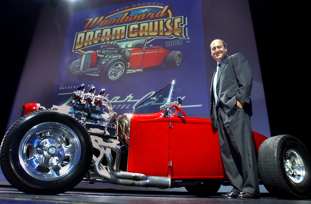 . Tony Michaels, Executive Director of the Woodward Dream Cruise, next to the 1931 Ford Roadster, owned by Jimmy George, of Waterford and featured in this year\'s logo, at a press conference at the Motor City Casino in Detroit. Michaels announced that the casino will be a main presenter at the event this August.