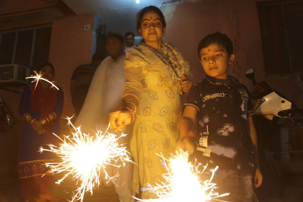 . Indians light fireworks to celebrate Diwali in Jammu, Thursday, Oct. 19, 2017.  Hindus light lamps, wear new clothes, exchange sweets and gifts and pray to goddess Lakshmi during Diwali, the festival of lights. (AP Photo/Channi Anand)
