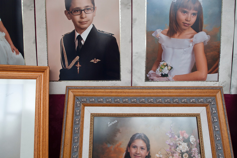First Communion photographs on a shop window, Seville, Spain