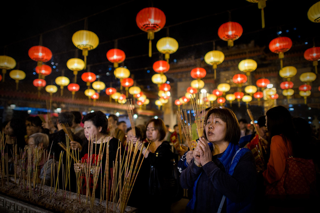 . Worshippers burn incense and pray at the Wong Tai Sin Temple to welcome the Chinese New Year of the horse in Hong Kong on January 30, 2014. AFP PHOTO / Philippe LOPEZ/AFP/Getty Images