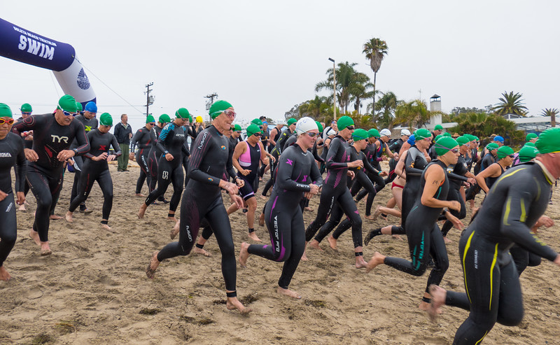 The third wave of swimmers heading out