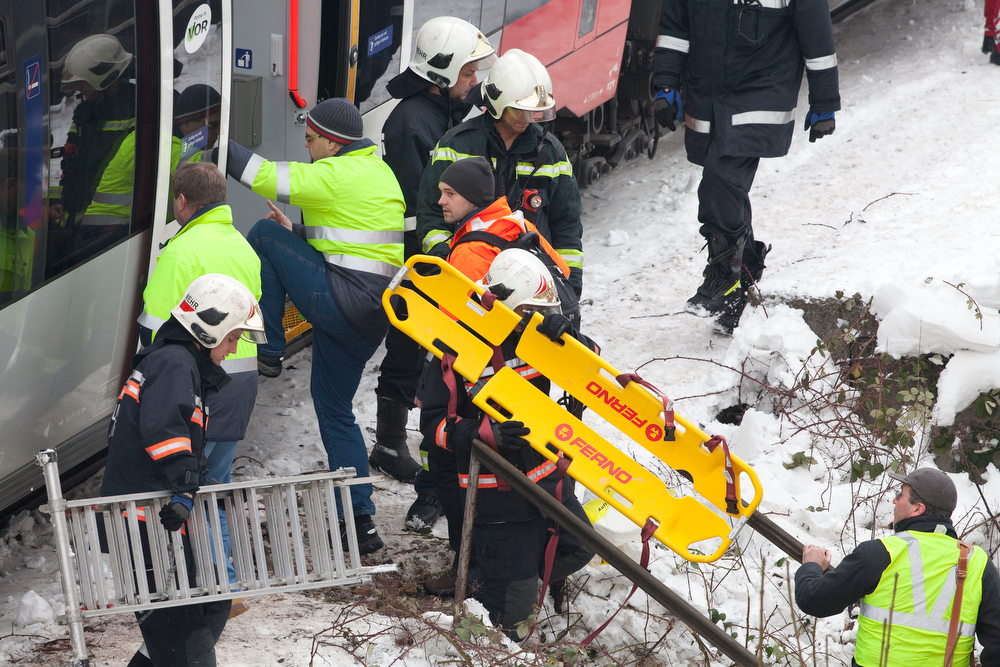 Description of . Firefighters climb aboard to rescue passengers of the  two trains of the line S45 crashed on January 21, 2013 in Vienna, Austria AFP PHOTO / DIETER NAGLDIETER NAGL/AFP/Getty Images