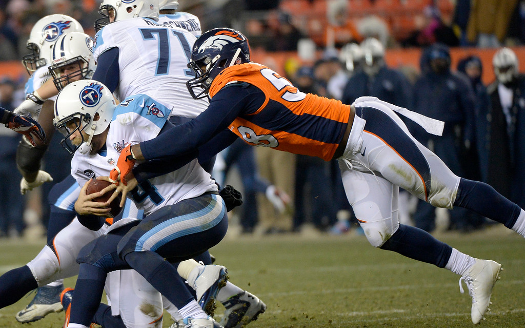 . Denver Broncos outside linebacker Von Miller (58) reaches out for a sac on Tennessee Titans quarterback Ryan Fitzpatrick (4) during the fourth quarter.   (Photo by Joe Amon/The Denver Post)