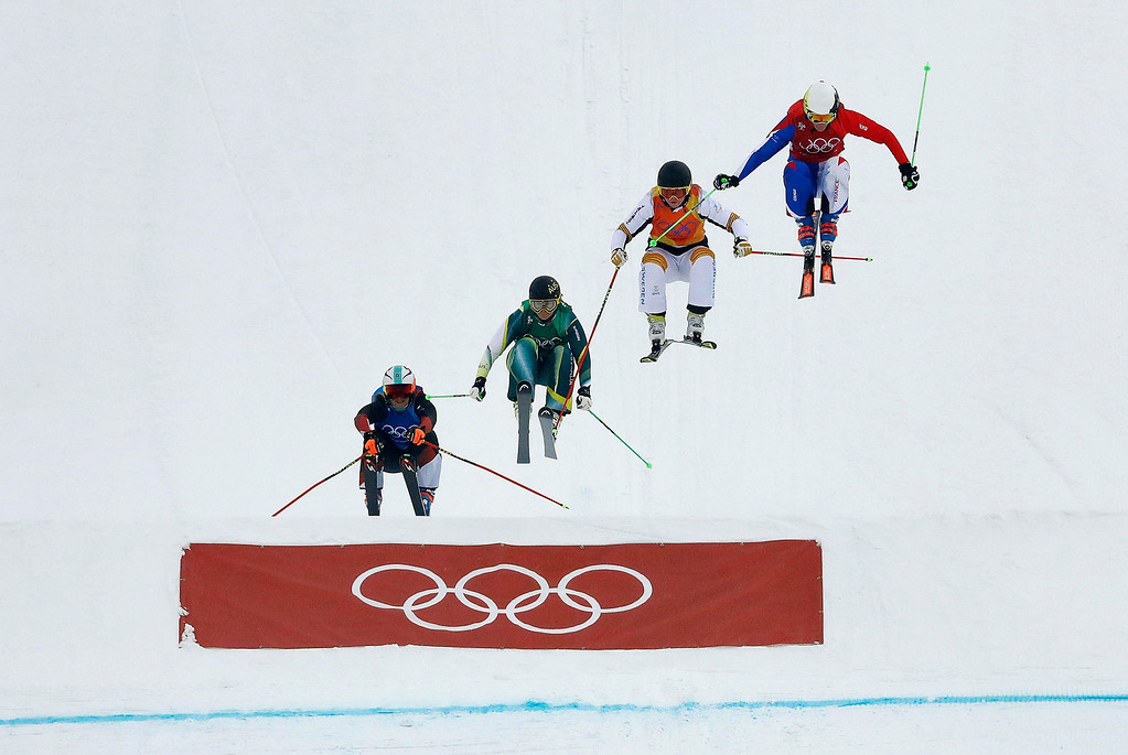 . From left; Sanna Luedi, of Switzerland, Sami Kennedy-Sim, of Australia, Lisa Andersson, of Sweden, and Alizee Baron, of France, run the course during the women\'s ski cross small final at Phoenix Snow Park at the 2018 Winter Olympics in Pyeongchang, South Korea, Friday, Feb. 23, 2018. (AP Photo/Kin Cheung) (AP Photo/Lee Jin-man)