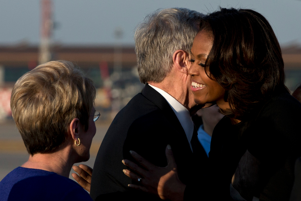 . U.S. First Lady Michelle Obama, right, is greeted by Max Baucus, center, the new U.S. Ambassador to China, and his wife Melodee Hanes, left, upon her arrival at Capital International Airport in Beijing, China, Thursday, March 20, 2014. Michelle Obama has arrived in Beijing with her mother and daughters to kick off a seven-day, three-city tour where she will focus on education and cultural exchange. (AP Photo/Alexander F. Yuan, Pool)
